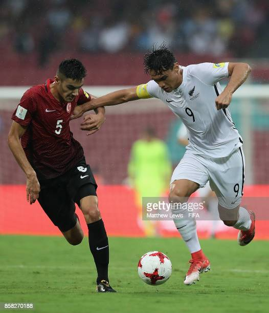 Max Mata of New Zealand holds off Ozan Kabak of Turkey during the FIFA U17 World Cup India 2017 group B match between New Zealand and Turkey at Dr DY...