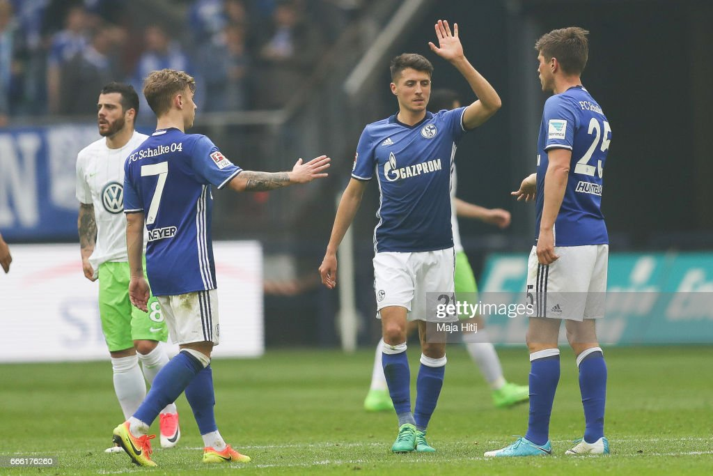 Max Meyer (L-R), Alessandro Schoepf and Klaas-Jan Huntelaar of Schalke celebrate after the Bundesliga match between FC Schalke 04 and VfL Wolfsburg at Veltins-Arena on April 8, 2017 in Gelsenkirchen, Germany.