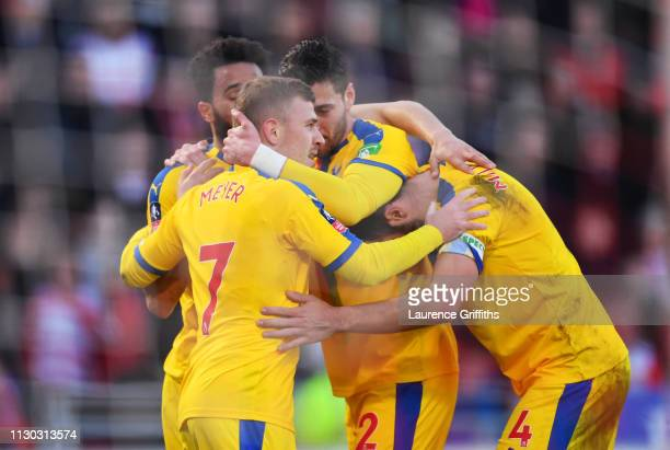Max Meyer of Crystal Palace celebrates as he scores his team's second goal with team mates during the FA Cup Fifth Round match between Doncaster...