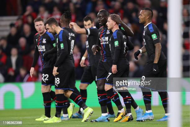 Max Meyer of Crystal Palace celebrates with teammates after scoring a goal which is then disallowed for offside following a VAR review during the...