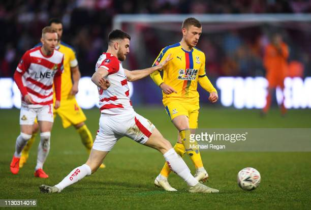 Max Meyer of Crystal Palace is challeged by Benjamin Whiteman of Doncaster Rovers during the FA Cup Fifth Round match between Doncaster Rovers and...