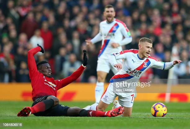 Max Meyer of Crystal Palace is challenged by Paul Pogba of Manchester United during the Premier League match between Manchester United and Crystal...