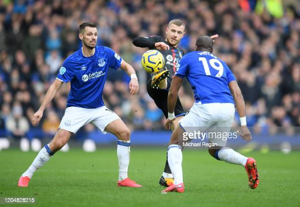 Max Meyer of Crystal Palace is put under pressure by Morgan Schneiderlin and Djibril Sidibe of Everton FC during the Premier League match between...