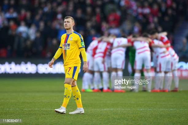Max Meyer of Crystal Palace looks on as Doncaster Rovers players huddle prior to the FA Cup Fifth Round match between Doncaster Rovers and Crystal...