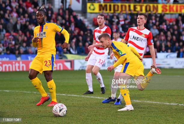 Max Meyer of Crystal Palace scores his team's second goal as team mate Michy Batshuayi looks on during the FA Cup Fifth Round match between Doncaster...