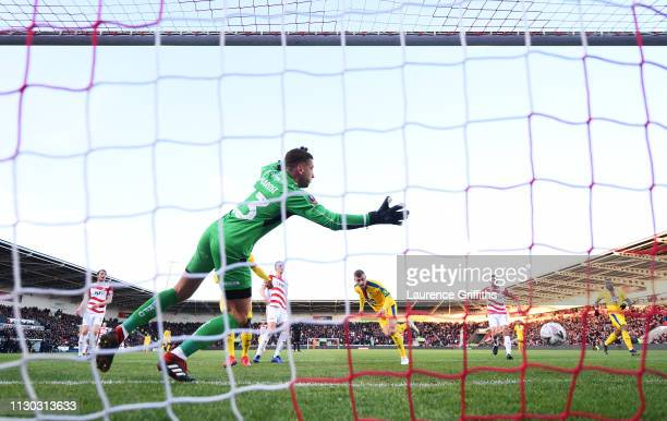 Max Meyer of Crystal Palace scores his team's second goal past Marko Marosi of Doncaster Rovers during the FA Cup Fifth Round match between Doncaster...