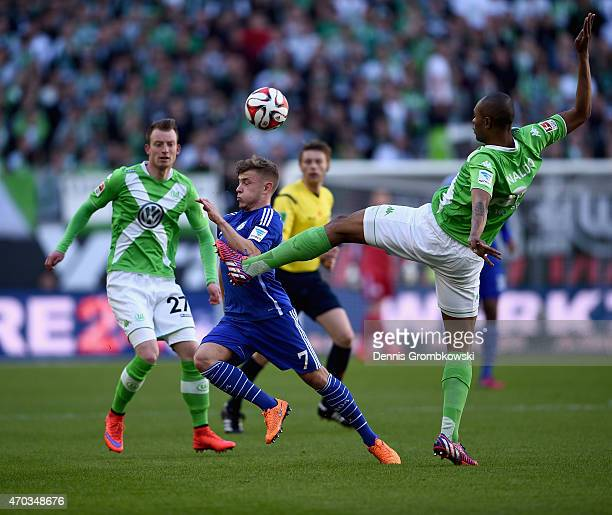 Max Meyer of FC Schalke 04 is challenged by Naldo of VfL Wolfsburg during the Bundesliga match between VfL Wolfsburg and FC Schalke 04 at Volkswagen...