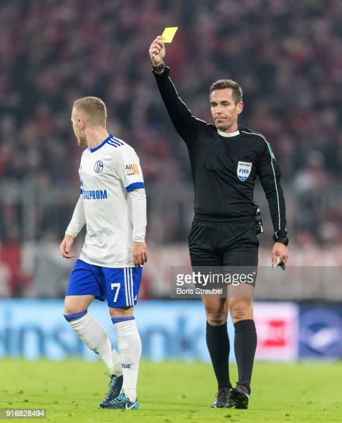 Max Meyer of FC Schalke 04 is shown a yellow card during the Bundesliga match between FC Bayern Muenchen and FC Schalke 04 at Allianz Arena on...