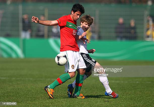 Max Meyer of Germany and Cristian of Portugal battle for the ball during the U17 Men's Elite Round match between Germany and Portugal on March 25...