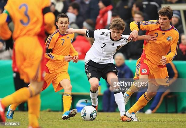 Max Meyer of Germany and Mihai Alexandru Balasa of Romania battle for the ball during the U16 International friendly match between Germany and...