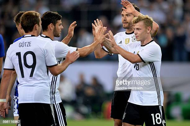 Max Meyer of Germany celebrates with team mates after scoring the opening goal during the international friendly match between Germany and Finland at...