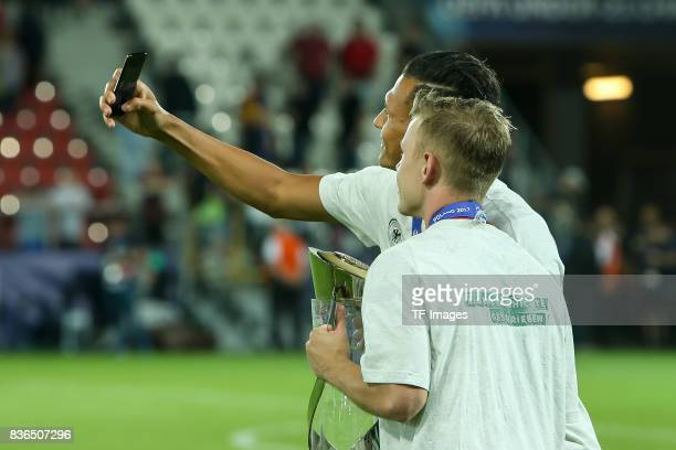 Max Meyer of Germany Davie Selke of Germany celebrates with the trophy after the UEFA U21 Final match between Germany and Spain at Krakow Stadium on...