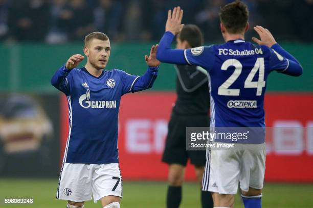 Max Meyer of Schalke 04 Bastian Oczipka of Schalke 04 celebrates the victory during the German DFB Pokal match between Schalke 04 v 1 FC Koln at the...