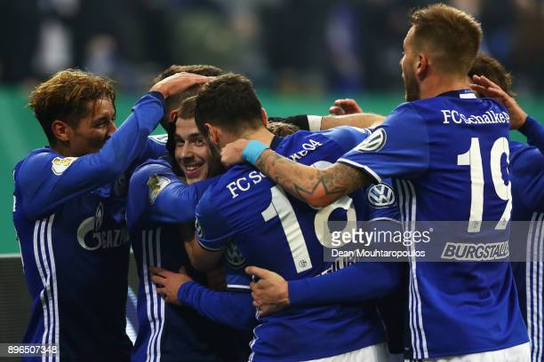 Max Meyer of Schalke 04 celebrates scoring his teams first goal of the game with team mates during the DFB Pokal match between FC Schalke 04 and 1 FC...