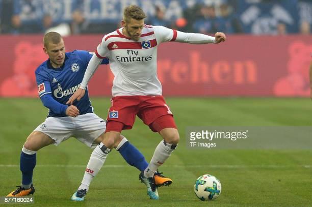 Max Meyer of Schalke and Aaron Hunt of Hamburg battle for the ball during the Bundesliga match between FC Schalke 04 and Hamburger SV at VeltinsArena...