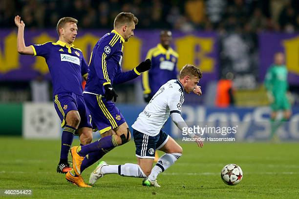 Max Meyer of Schalke battles for the ball with Ales Mertelj of Maribor and his team mate Zeljko Filipovic during the UEFA Group G Champions League...