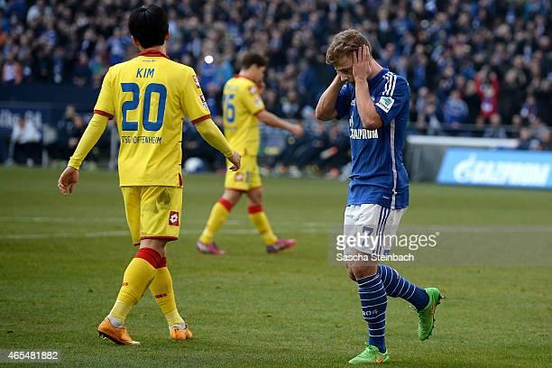 Max Meyer of Schalke celebrates after scoring his team's second goal as Jin-Su Kim of Hoffenheim looks dejected during the Bundesliga match between...
