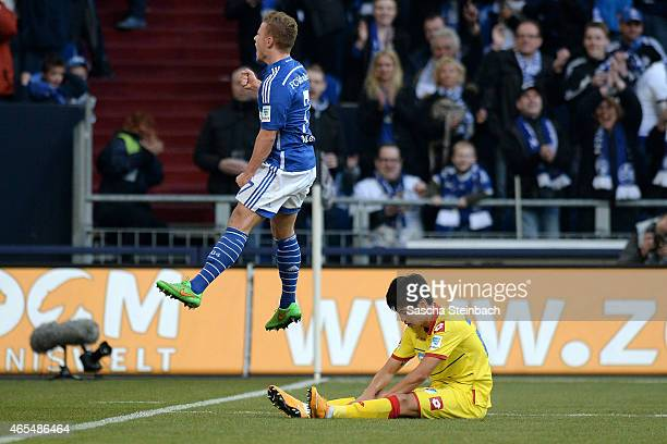Max Meyer of Schalke celebrates after scoring his team's third goal as JinSu Kim of Hoffenheim looks dejected during the Bundesliga match between FC...