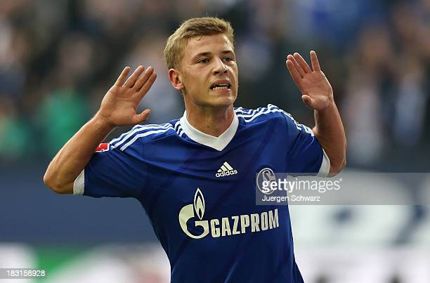 Max Meyer of Schalke celebrates after scoring their fourth goal during the Bundesliga match between FC Schalke 04 and FC Augsburg at VeltinsArena on...