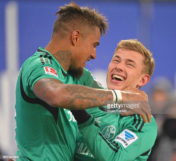 Max Meyer of Schalke celebrates his goal with Kevin Prince Boateng during the Bundesliga match between Hamburger SV and FC Schalke 04 at Imtech Arena...
