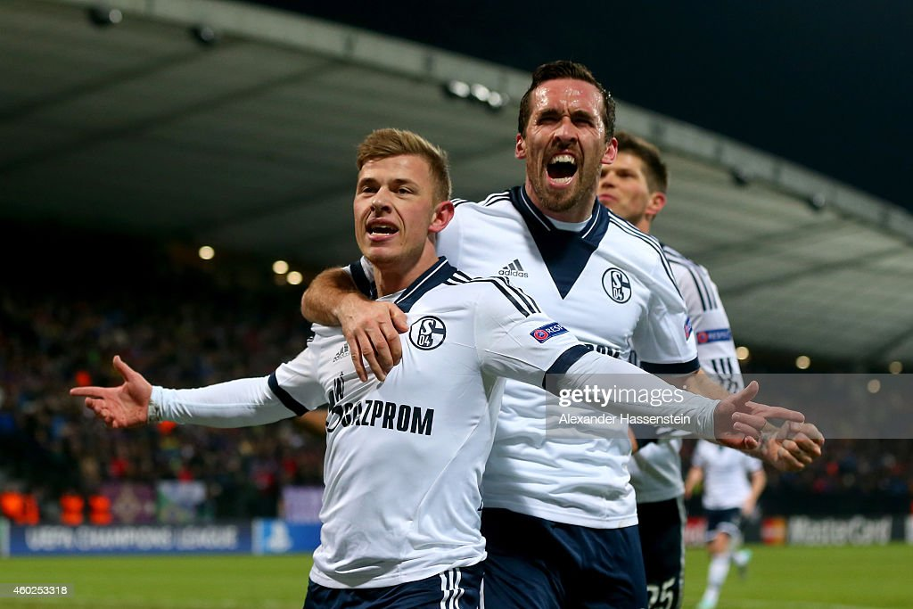 Max Meyer (L) of Schalke celebrates scoring the opening goal with his team mates Christian Fuchs (C) and Klaas-Jan Huntelaar during the UEFA Group G Champions League match between NK Maribor and FC Schalke 04 at Ljudski vrt Stadium on December 10, 2014 in Maribor, Slovenia.