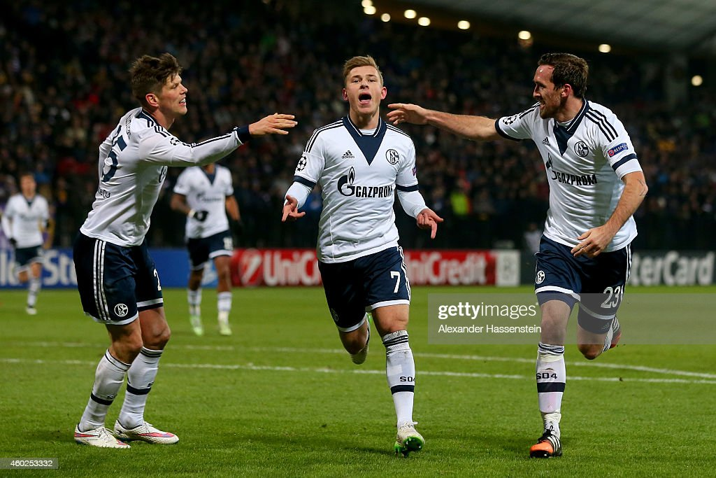 Max Meyer (C) of Schalke celebrates scoring the opening goal with his team mates Christian Fuchs (R) and Klaas-Jan Huntelaar (L) during the UEFA Group G Champions League match between NK Maribor and FC Schalke 04 at Ljudski vrt Stadium on December 10, 2014 in Maribor, Slovenia.