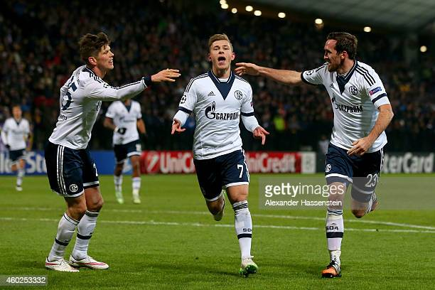 Max Meyer of Schalke celebrates scoring the opening goal with his team mates Christian Fuchs and KlaasJan Huntelaar during the UEFA Group G Champions...