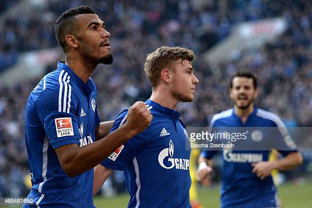 Max Meyer of Schalke celebrates with team mate Eric Maxim ChoupoMoting after scoring his team's second goal during the Bundesliga match between FC...