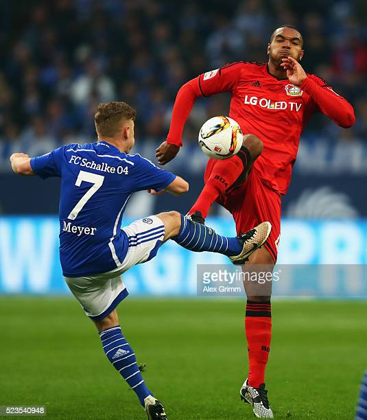 Max Meyer of Schalke is challenged by Jonathan Tah of Leverkusen during the Bundesliga match between FC Schalke 04 and Bayer Leverkusen at...