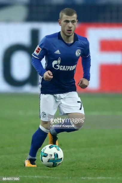 Max Meyer of Schalke runs with the ball during the Bundesliga match between FC Schalke 04 and 1 FC Koeln at VeltinsArena on December 2 2017 in...