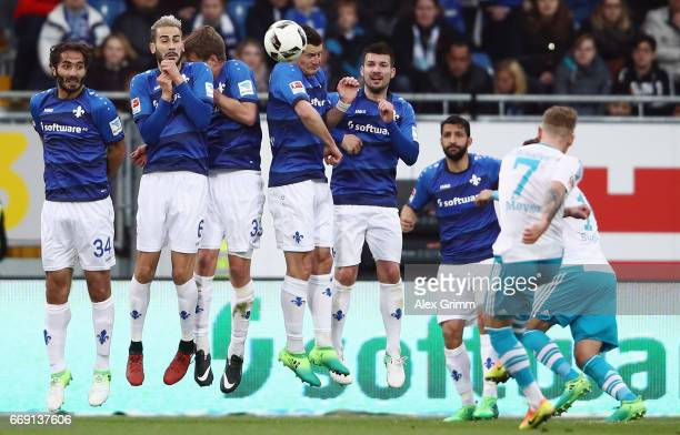 Max Meyer of Schalke shoots a freekick during the Bundesliga match between SV Darmstadt 98 and FC Schalke 04 at Stadion am Boellenfalltor on April 16...
