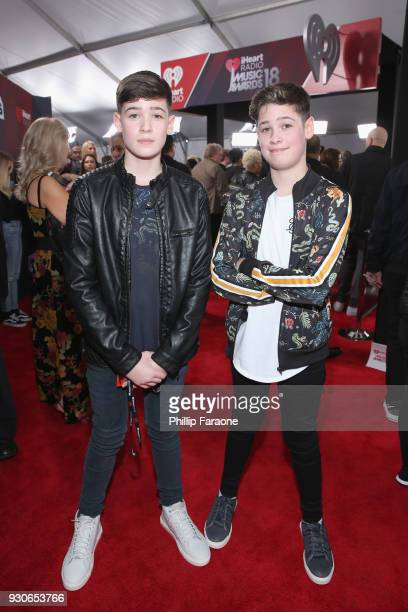 Max Mills and Harvey Mills of Max and Harvey pose in the press room during the 2018 iHeartRadio Music Awards which broadcasted live on TBS TNT and...