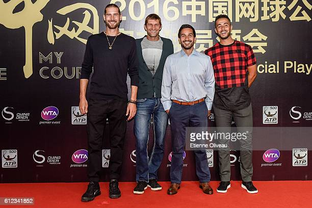 Max Mirnyi and his coach with Treat Huey of Phillipines and his coach of Belarus arrive at the 2016 China Open Player Party at The Birds Nest on...