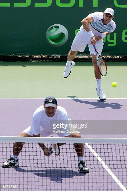 Max Mirnyi of Belarus and Andy Ram of Israel compete against Jeff Coetzee of South Africa and Wesley Moodie of South Africa during day nine of the...
