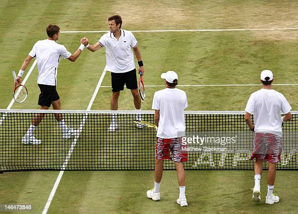 Max Mirnyi of Belarus and Daniel Nestor of Canada celebrate match point after winning their mens double final round match against Bob Bryan and Mike...