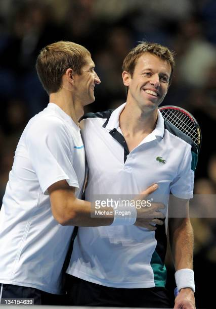 Max Mirnyi of Belarus and Daniel Nestor of Canada celebrate winning the men's doubles final match against Mariusz Fyrstenberg of Poland and Marcin...