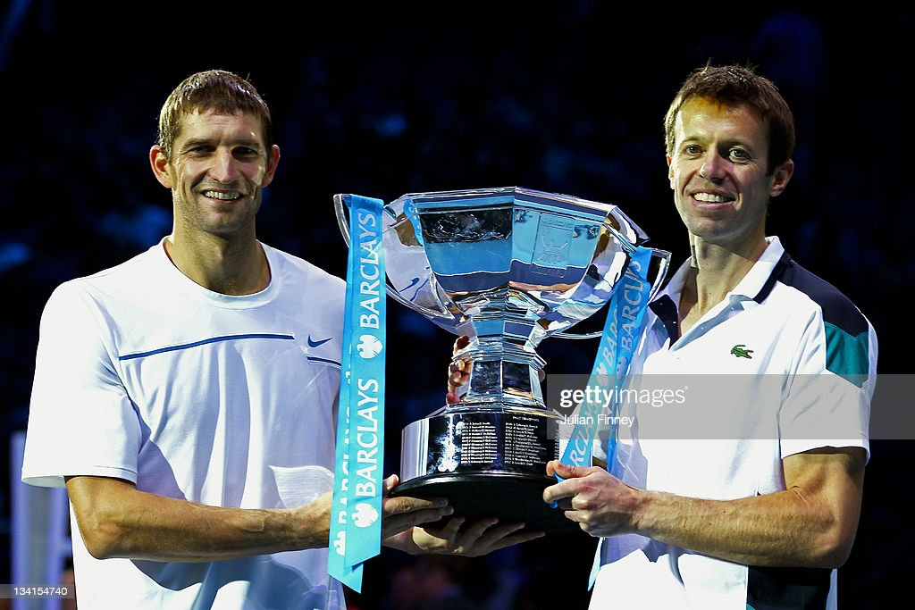 Max Mirnyi of Belarus and Daniel Nestor of Canada lift the trophy following their victory during the men's doubles final match against Mariusz Fyrstenberg of Poland and Marcin Matkowski of Poland during the Barclays ATP World Tour Finals at the O2 Arena on November 27, 2011 in London, England.