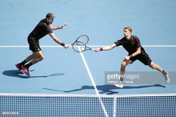 Max Mirnyi of Belarus and Philipp Oswald of Austria play a shot in their doubles semi final match against Michael Venus of New Zealand and Raven...