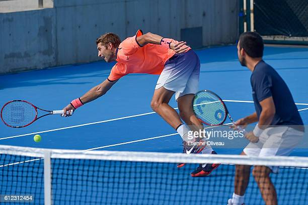 Max Mirnyi of Belarus and Treat Huey in action during the Men's double first round match against Paolo Lorenzi of Italy and Guido Pella of Argentina...