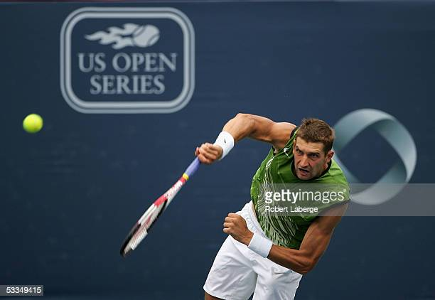 Max Mirnyi of Belarus serves to Greg Rusedski of Great Britain in their second round match at the ATP Rogers Cup Masters tennis tournament on August...