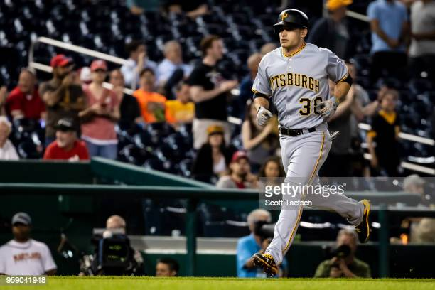 Max Moroff of the Pittsburgh Pirates hits a two run home run during the ninth inning against the Washington Nationals at Nationals Park on May 1 2018...