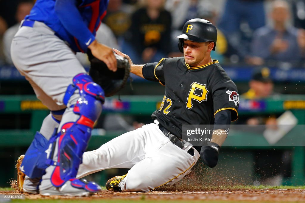 Max Moroff #62 of the Pittsburgh Pirates scores on a RBI single in the eighth inning against the Chicago Cubs at PNC Park on September 5, 2017 in Pittsburgh, Pennsylvania.