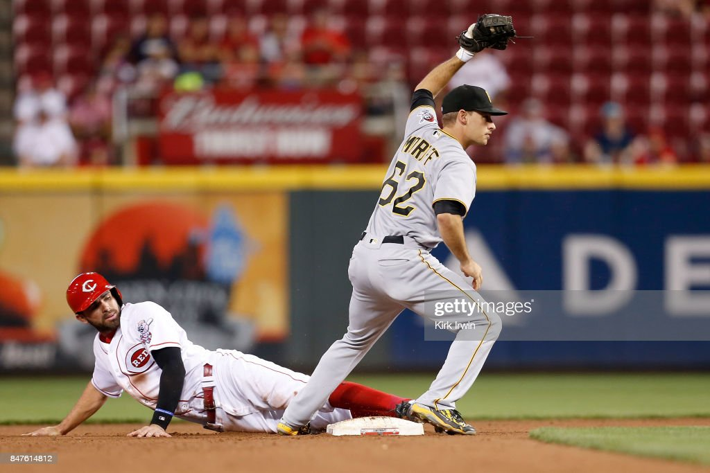 Max Moroff #62 of the Pittsburgh Pirates tags out Jose Peraza #9 of the Cincinnati Reds while attempting to steal second base during the fourth inning at Great American Ball Park on September 15, 2017 in Cincinnati, Ohio. Cincinnati defeated Pittsburgh 4-2.
