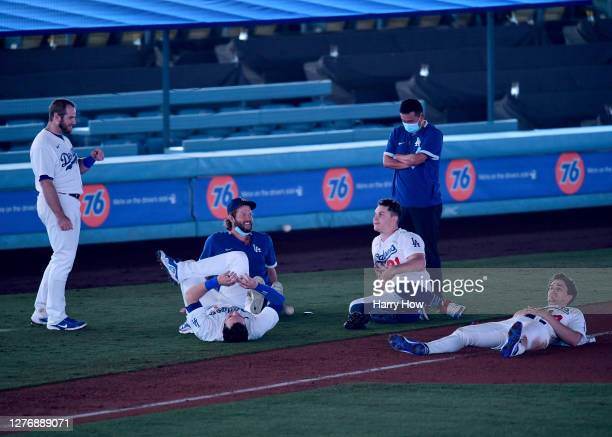 Max Muncy, A.J. Pollock, Clayton Kershaw Joc Pederson and Enrique Hernandez of the Los Angeles Dodgers wait on the field for the power to be restored...