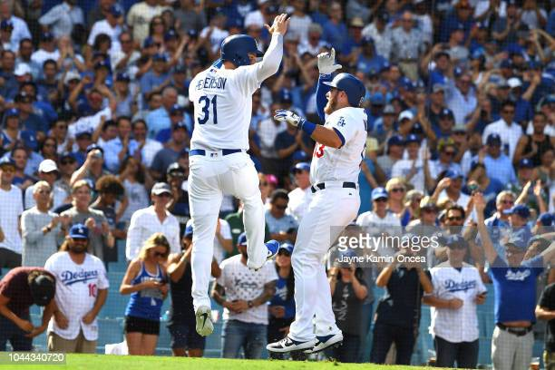 Max Muncy celebrates with Joc Pederson of the Los Angeles Dodgers after hitting a two run home run in the sixth inning of the game against the...