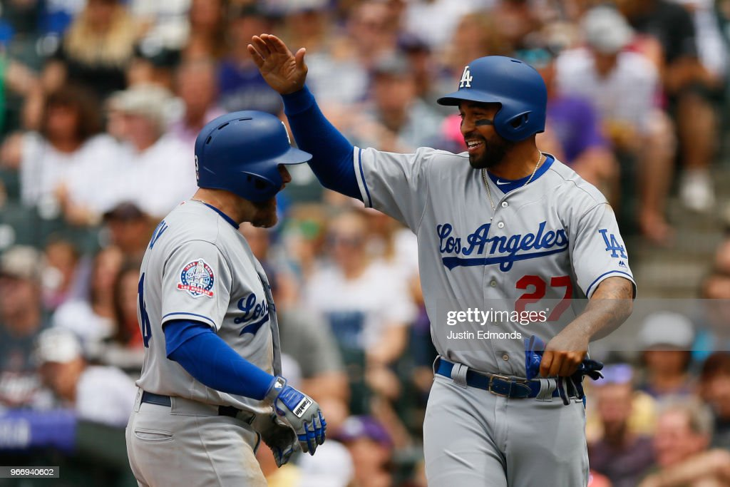 Max Muncy #13 is congratulated by Matt Kemp #27 of the Los Angeles Dodgers after hitting a three run home run during the third inning against the Colorado Rockies at Coors Field on June 3, 2018 in Denver, Colorado.