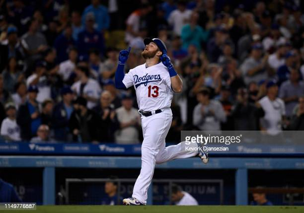 Max Muncy of the Los Angeles Dodgers celebrate after hitting a two run home run against Chicago Cubs during the fourth inning to at Dodger Stadium on...