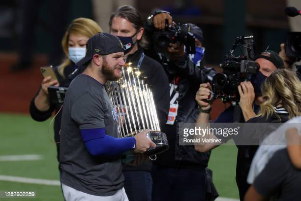 Max Muncy of the Los Angeles Dodgers celebrates after defeating the Tampa Bay Rays 3-1 in Game Six to win the 2020 MLB World Series at Globe Life...