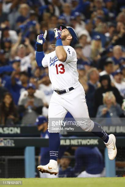 Max Muncy of the Los Angeles Dodgers celebrates as he rounds the bases after hitting a solo home run in the seventh inning in game two of the...