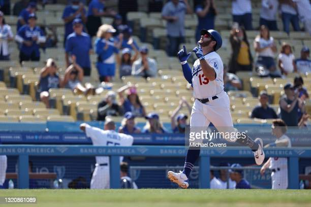 Max Muncy of the Los Angeles Dodgers celebrates as he runs home after hitting a two-run home run against the San Francisco Giants during the eighth...